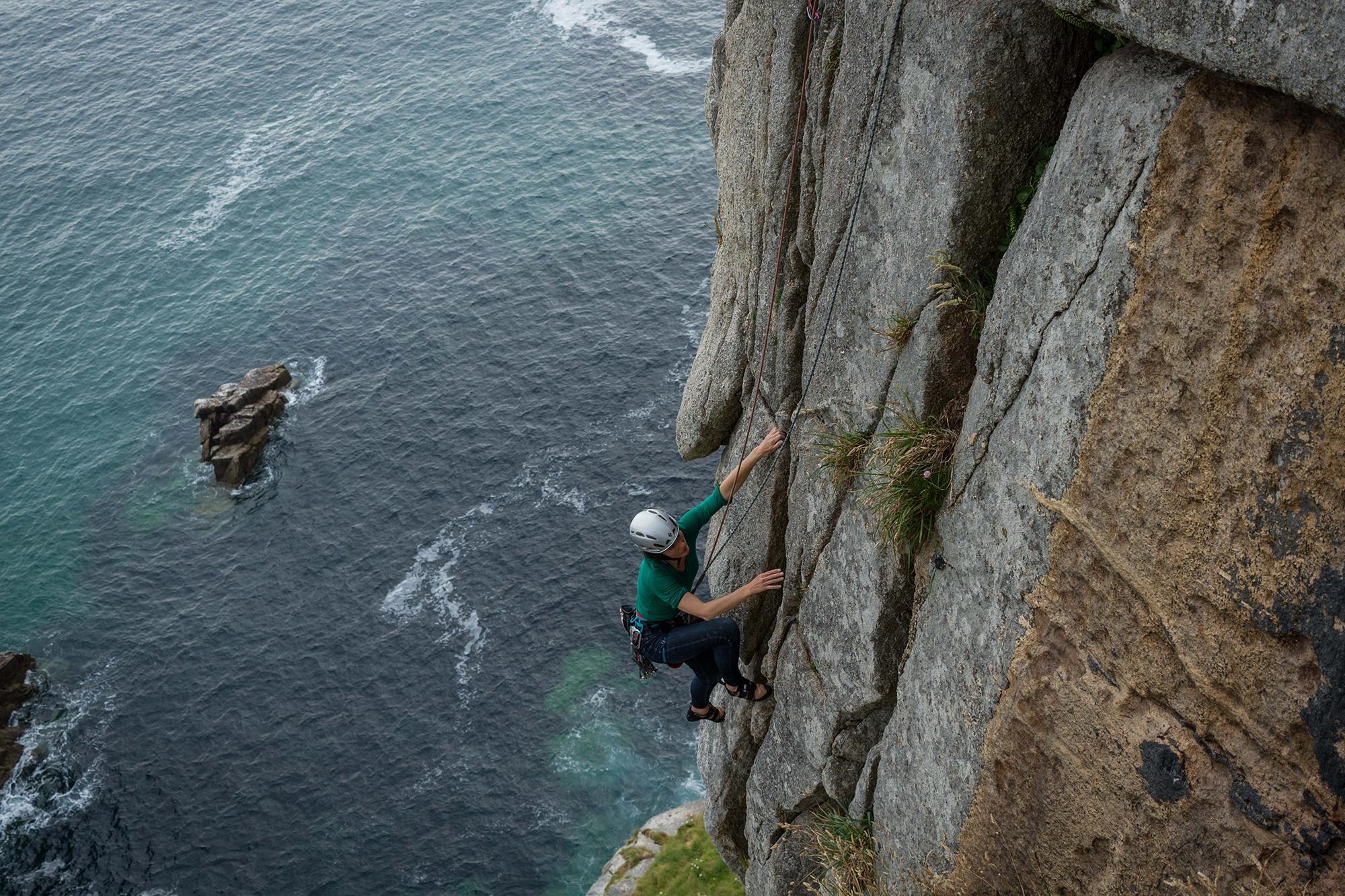 Photograph of Joan Stewart climbing on Doorpost, shot by Jessie Leong