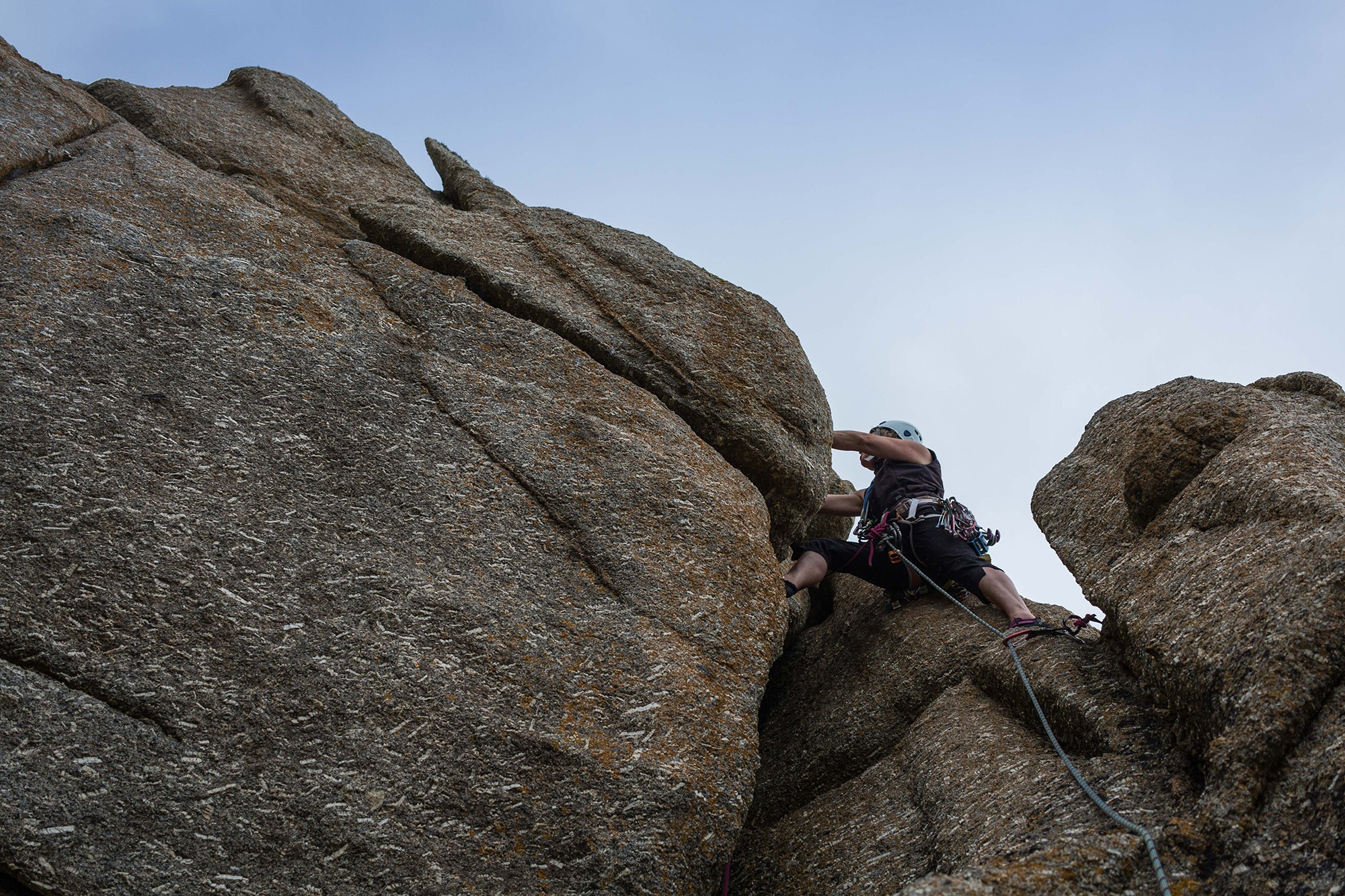 Val Climbing on Helluva Slab in Cornwall. Photographed by Jessie Leong