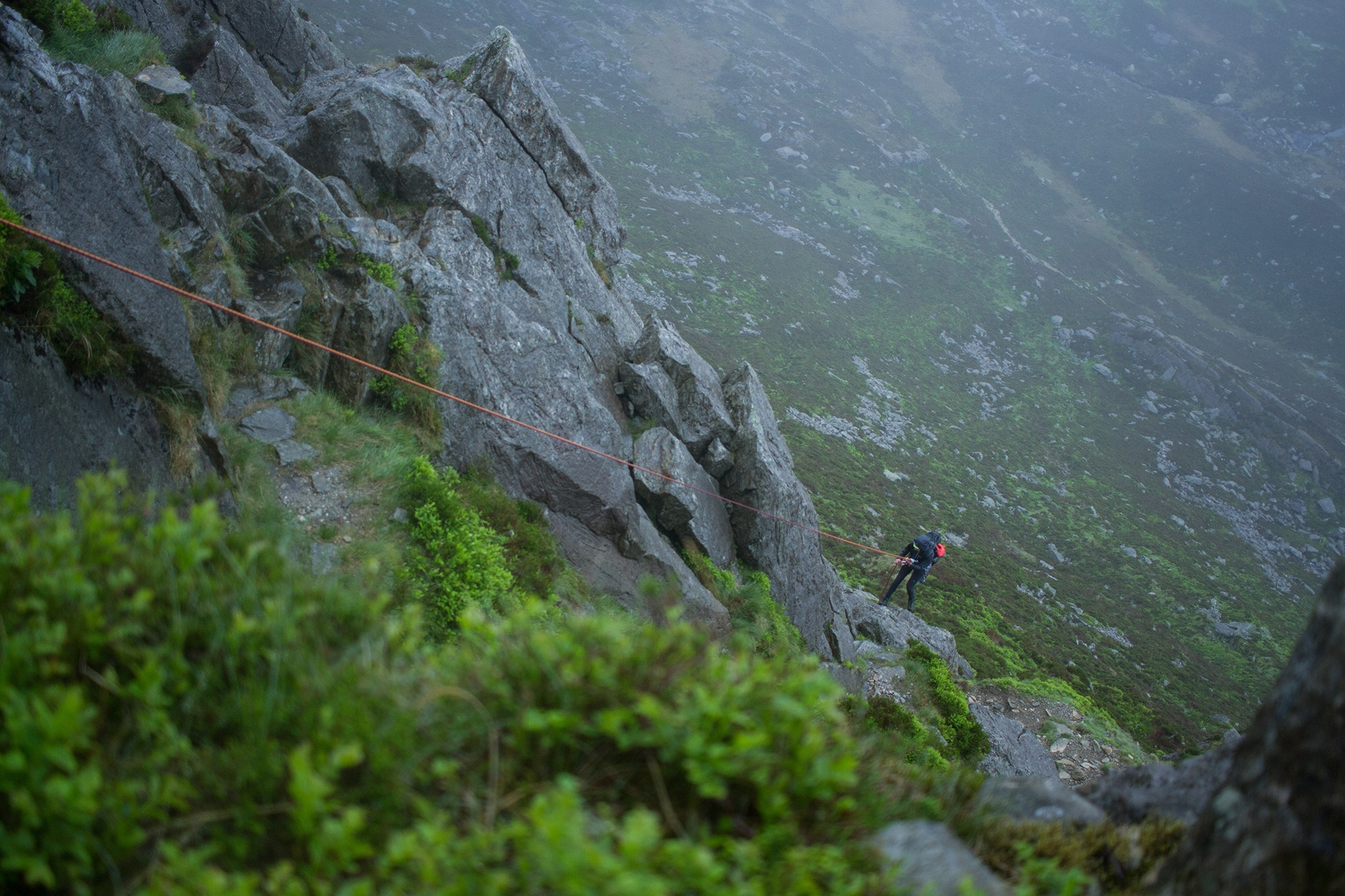 Emma Cooper abseiling off Grooved Arete
