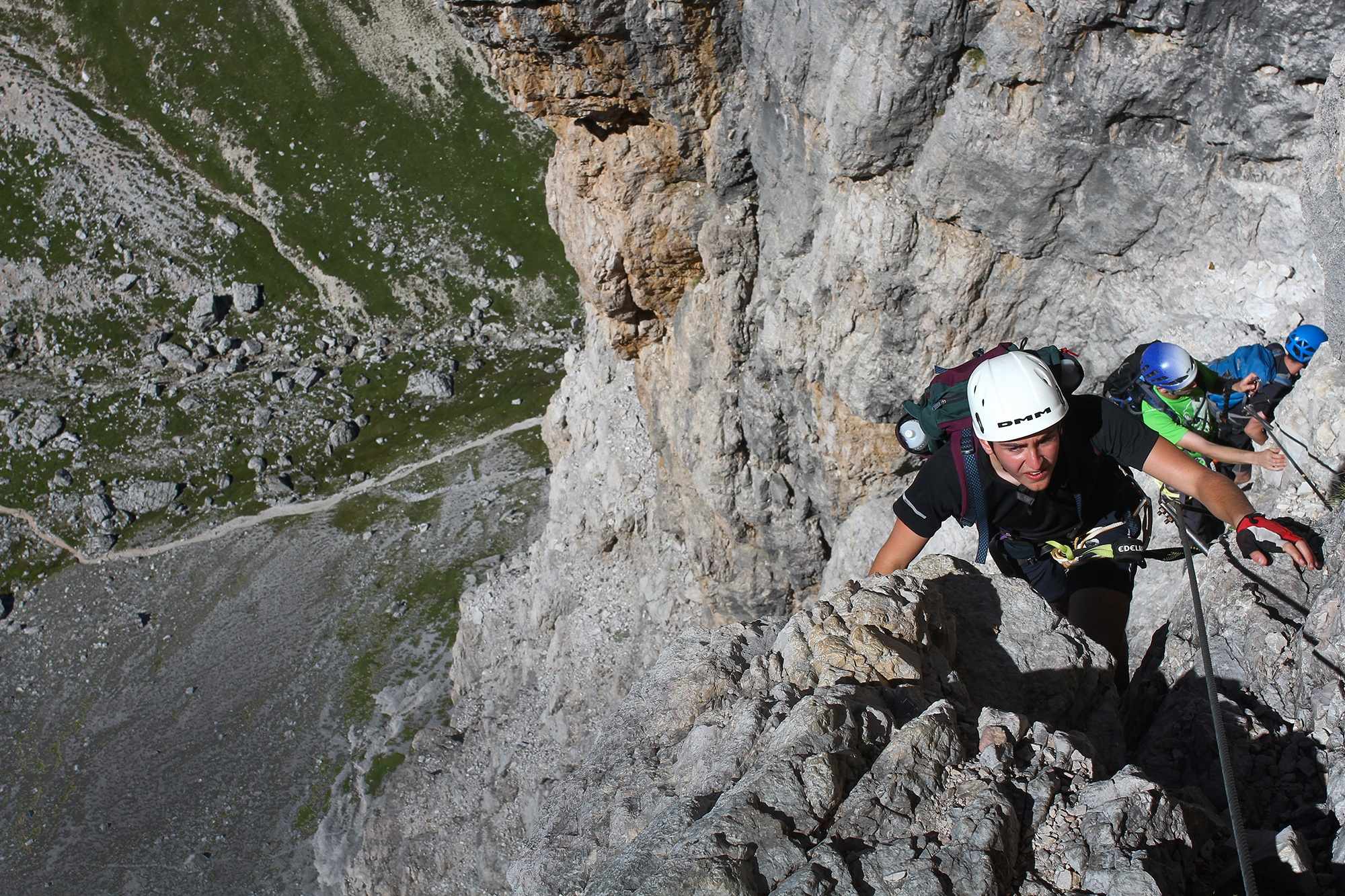 Tom Fullen topping out of the Dolomites Via Ferrata route