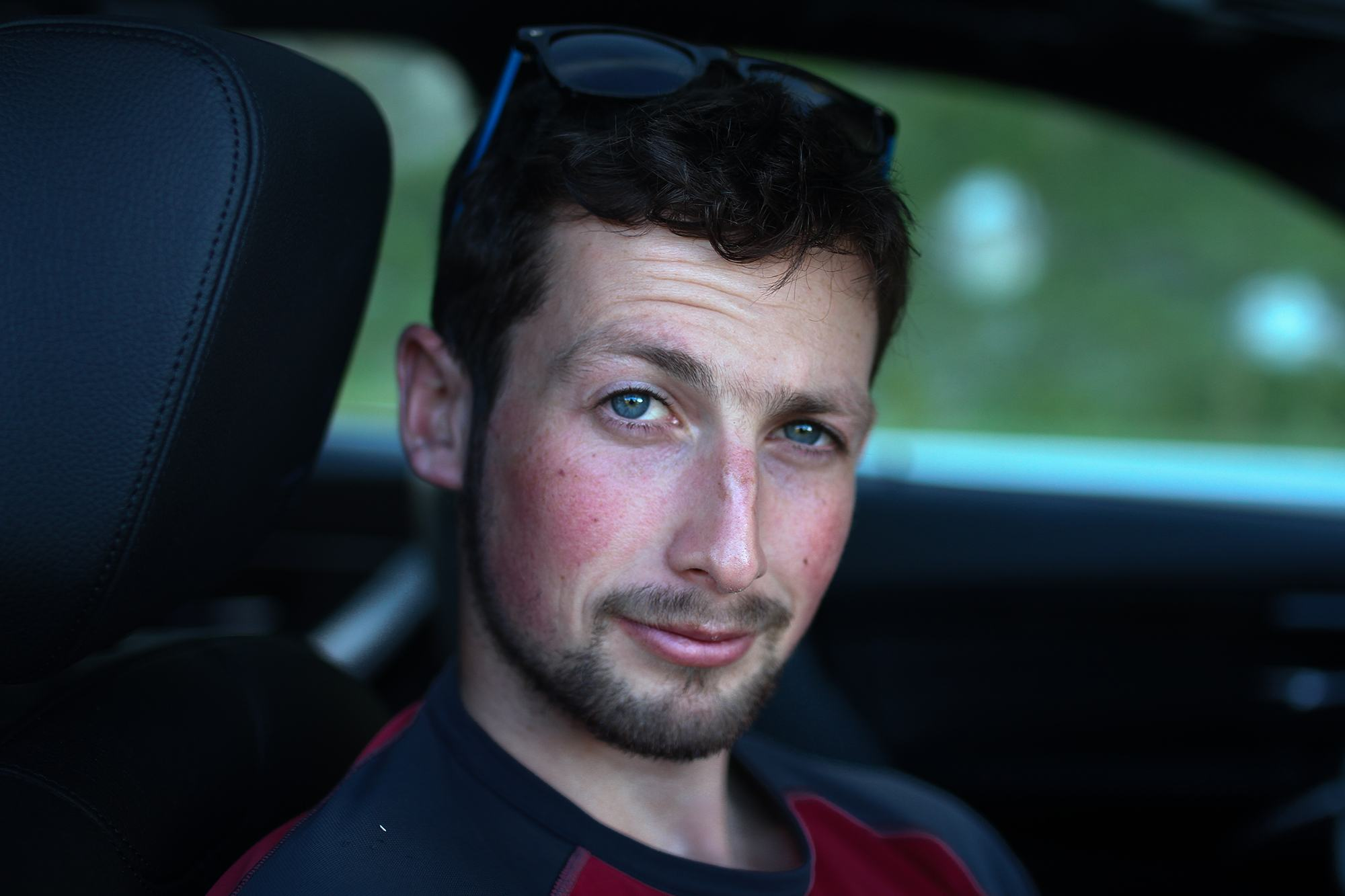 Photograph of Mike Daniels, sat in a car in The Dolomites