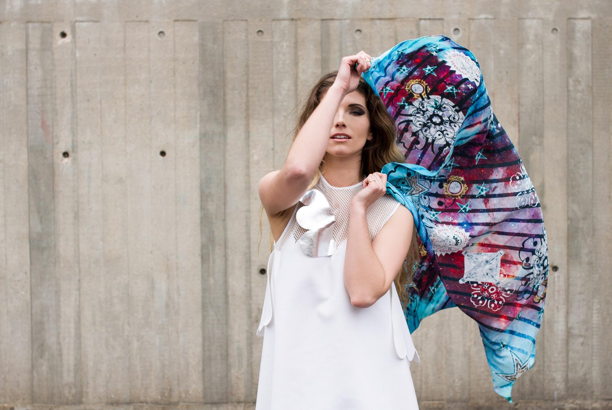 Model holding Lavinia Cadar Scarf as a flag
