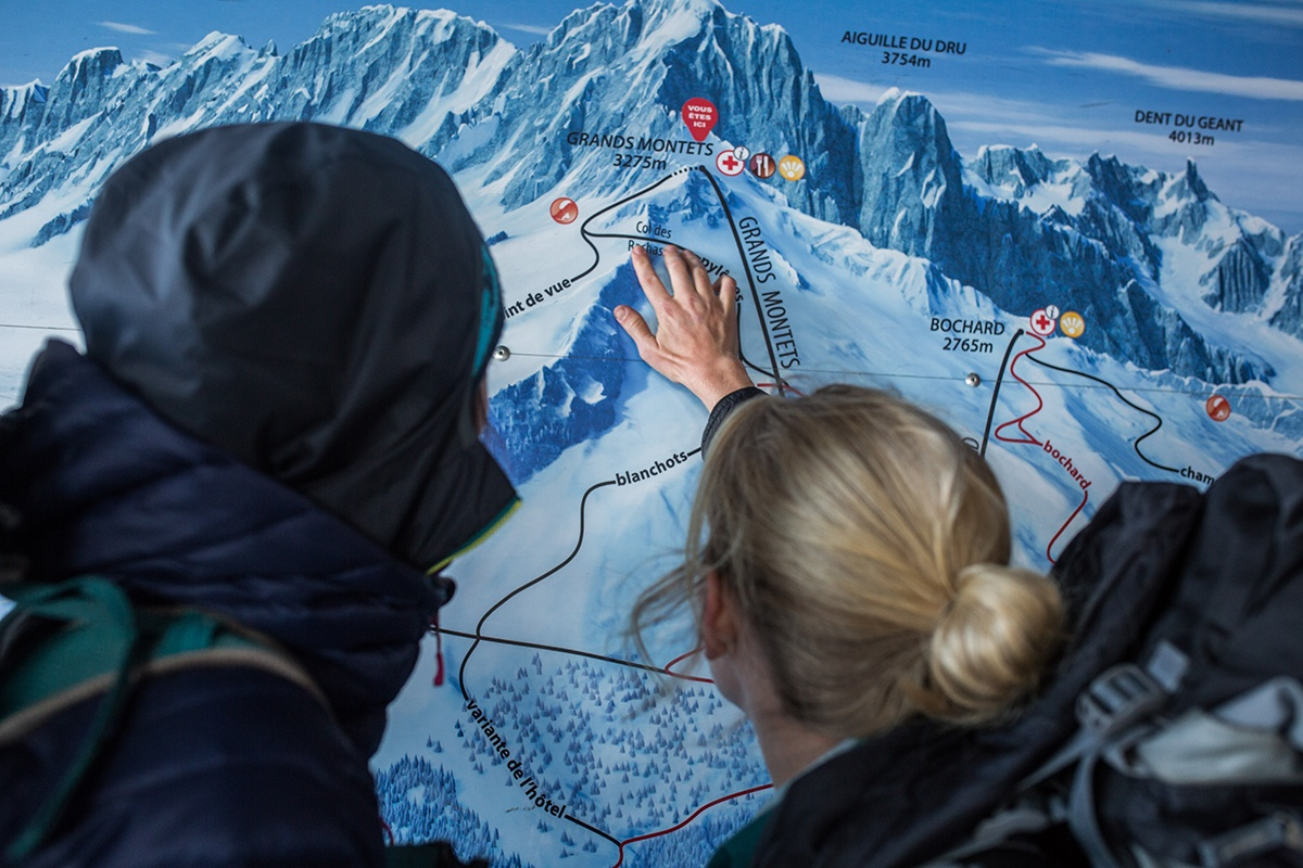 Emma and Coops point at Grand Montets Map